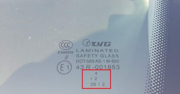 Необычная маркировка даты выпуска стекла фирмой Xyg